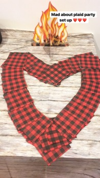 Fire centerpieces, birch table cloths, and plaid napkins